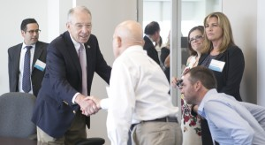 Senator Chuck Grassley greets attendees at a town hall-style